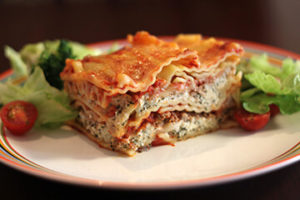 Try our delicious veggie Lasagna - the Layers of vegetables, pasta and cheese with tomato sauce au gratin are the perfect combo.